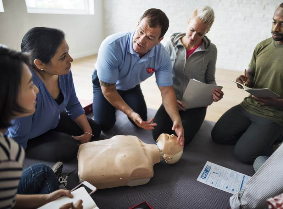 first aid training being done on a dummy