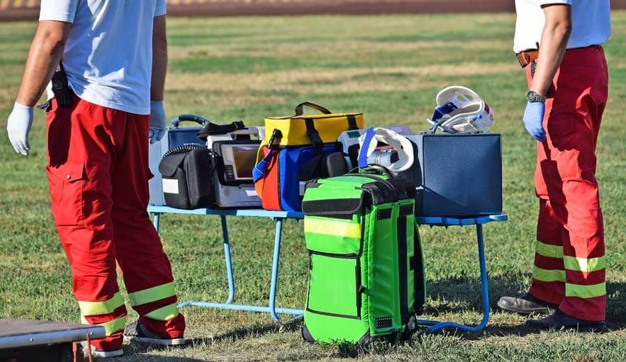 paramedics in a field with a medical table set up