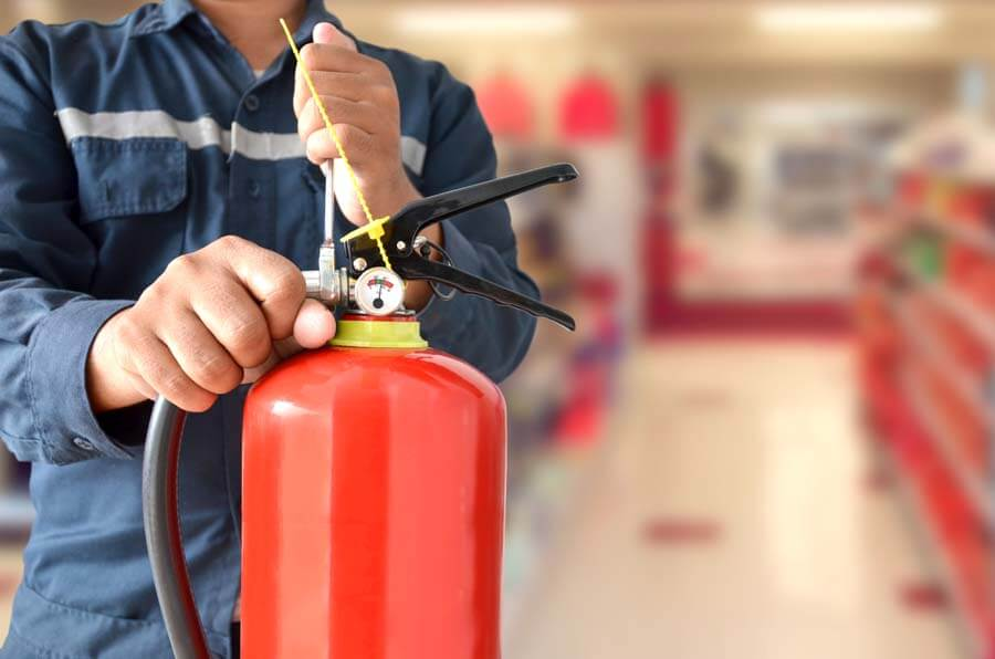 person testing tie on fire extinguisher