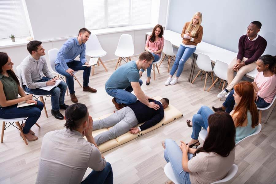 first aid training session with person performing cpr
